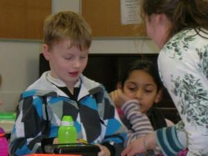 Child reading work aloud